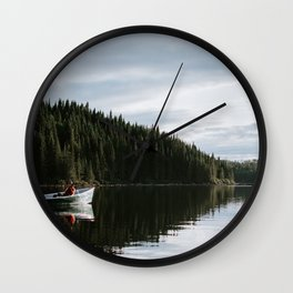 MEN ON MOTORBOAT UNDER CLOUDY SKY Wall Clock