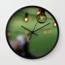 Incandescent Lights string an evening summer party. Wall Clock