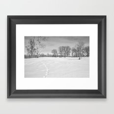 Footprints in the snow Framed Art Print
