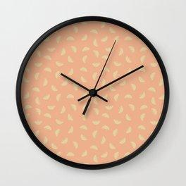 Bowl of falling fruit orange background Wall Clock