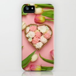 Tender tulips and a heart-shaped basket with meringues inside. Pink background iPhone Case