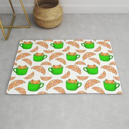 Cute happy playful funny Kawaii baby kittens sitting in little green espresso coffee cups, sweet adorable yummy croissants cartoon white design. Rug