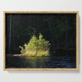 Small lush island in sunlight at lake shore Serving Tray