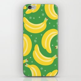 Vector bananas in a green background iPhone Skin