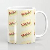 hamburger Mugs featuring Hamburger by Berta Merlotte