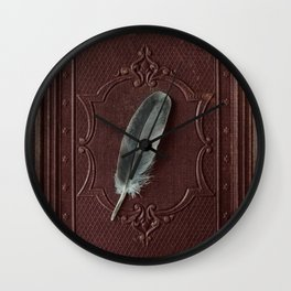 The lost feather Wall Clock