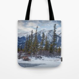 Pines at the edge of a lake in Jasper National Park Tote Bag