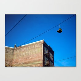 Shoe on the Telephone Line Canvas Print