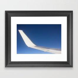 Airplane Wingtip on a blue sky Framed Art Print
