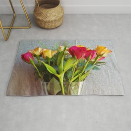 Flowers in a vase - with red and yellow roses Rug
