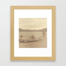 Children playing on a sepia-tone lakeshore Framed Art Print