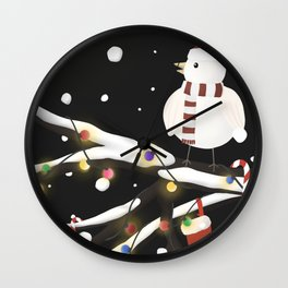 Lonely Bird on a snowy Christmas night Wall Clock