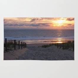 evening at the beach Rug