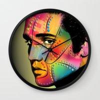 elvis presley Wall Clocks featuring Elvis Presley by mark ashkenazi