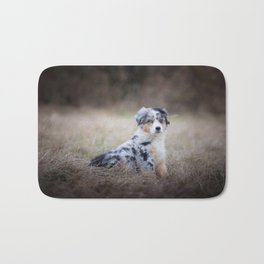 Serious dog in the field Bath Mat