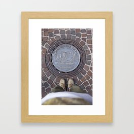 Man standing in front of a manhole Framed Art Print