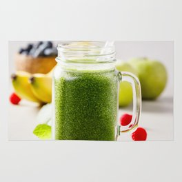 Close-up of green fresh smoothie with fruits, berries, oats and seeds, selective focus. Rug
