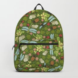 Dragonflies with bee amount clovers and apple blossom on green background Backpack