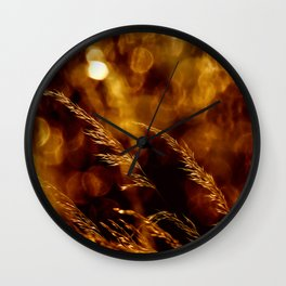 Sunset in the grass Wall Clock