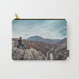 Girl sitting on the bench on the edge of the canyon with amazing view in front of her Carry-All Pouch