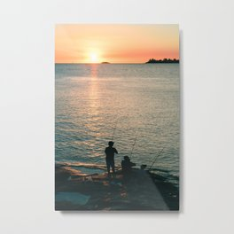Three fisherman enjoy a beautiful sunset at the shore of 'Colonia del Sacramento, Uruguay'. Metal Print