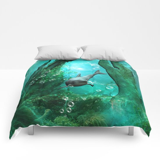Swimming dolphin Comforters