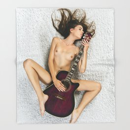 Nude on the floor holding a guitar Throw Blanket