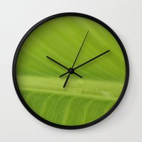 banana leaf Wall Clocks featuring Banana Leaf by Cassidy Marshall