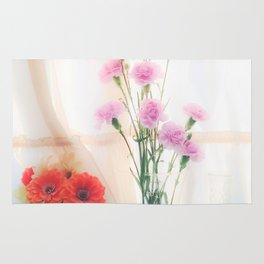 pink flower and orange flower in the vase with curtain background Rug
