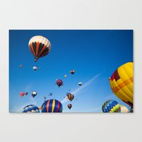 hot air balloons Canvas Prints featuring Vibrant Hot Air Balloons by Nicolas Raymond