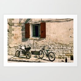 Two bikes against the wall Art Print