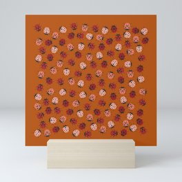 All over Modern Ladybug on burnt orange Background Mini Art Print