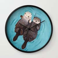 kim sy ok Wall Clocks featuring Otterly Romantic - Otters Holding Hands by When Guinea Pigs Fly
