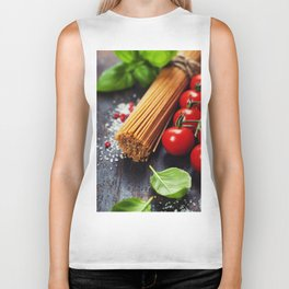 Spaghetti and tomatoes with herbs on an old and vintage wooden table Biker Tank