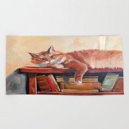 Red cat on a bookshelf Beach Towel