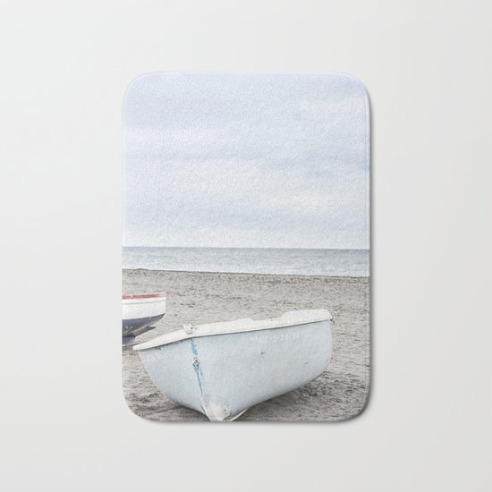Lonely boats at the beach Bath Mat
