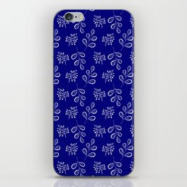 White laves on a deep blue iPhone Skin