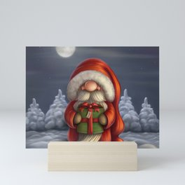 Little Santa with a gift Mini Art Print