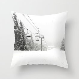 Lifts waiting for action in the snow Throw Pillow