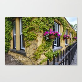 Yellow building with flowers Canvas Print
