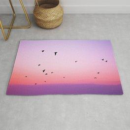 birds in the sky rose Rug