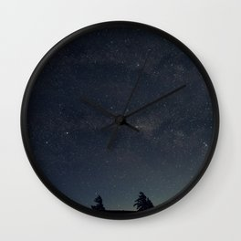 Starry night over the trees Wall Clock