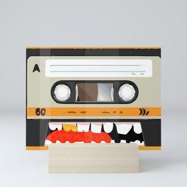 The cassette tape golden tooth Mini Art Print