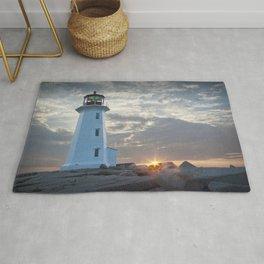 Sunrise at Peggys Cove Lighthouse in Nova Scotia Rug