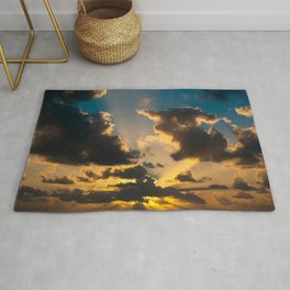 The last moment of the day in a cloudy sunset  Rug