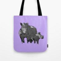 newspaper Tote Bags featuring Newspaper Rhinoceros by Doolin