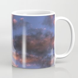 Small scattered clouds illuminated by the sunset sun Coffee Mug