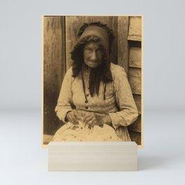 Doris Ulmann  (1882–1934), Elderly woman in bonnet, seated, making lace Mini Art Print