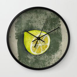 Lemon on dirty grunge green background. Wall Clock