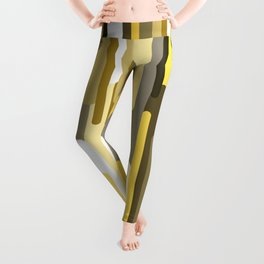 Flowing drops of paint in gold yellow, abstract liquid flow, golden background Leggings